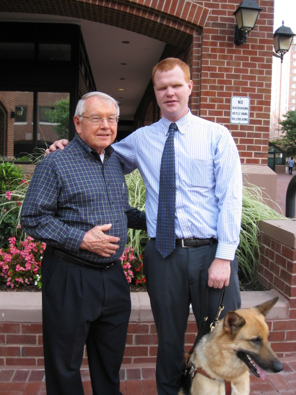 Ned Rupp and Tim Fallon with Orson (German Shepherd),